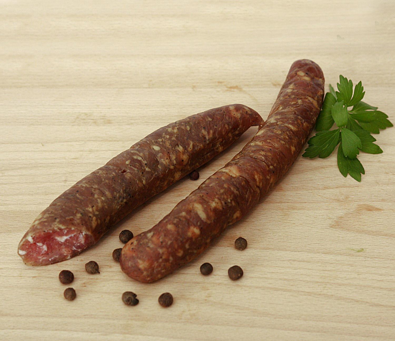kiełbasa polskatradycyjna, z mięsa z szyki, grubo mielone, wędzona zimnym dymem, nie parzona.