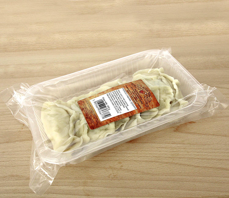 pierogi z kapustą i grzybamikapusta kiszona z pieczarkami z dodatkiem suszonego borowika, 9 szt w opakowaniu na tacce